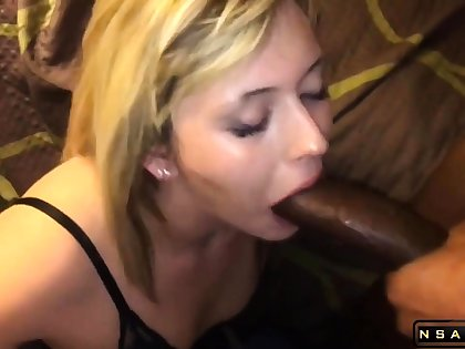 Attractive blonde milf takes a huge black cock in her mouth