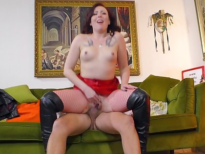 Redhead slut in fishnet stockings gets fucked hard by an older dude