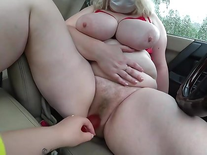 Lesbian fucked mature milf in the car. Big tits and fat ass in sexy underwear. POV.