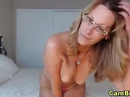 my stepmother rides a chunky dildo inside her juicy pussy