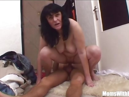 Grotesque milf and a young guy are having a profligate sex action, in the bedroom