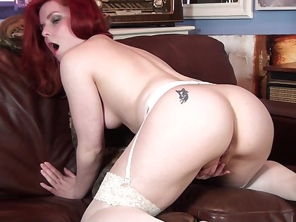 Redhead cougar Poline takes off her apparel to have some fun