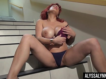 Gorgeous red head Alyssa Lynn is jilling off seize on the stairs