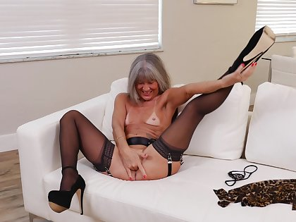 Small jugs mature Leilani Lei in stockings added to high heels having recreation